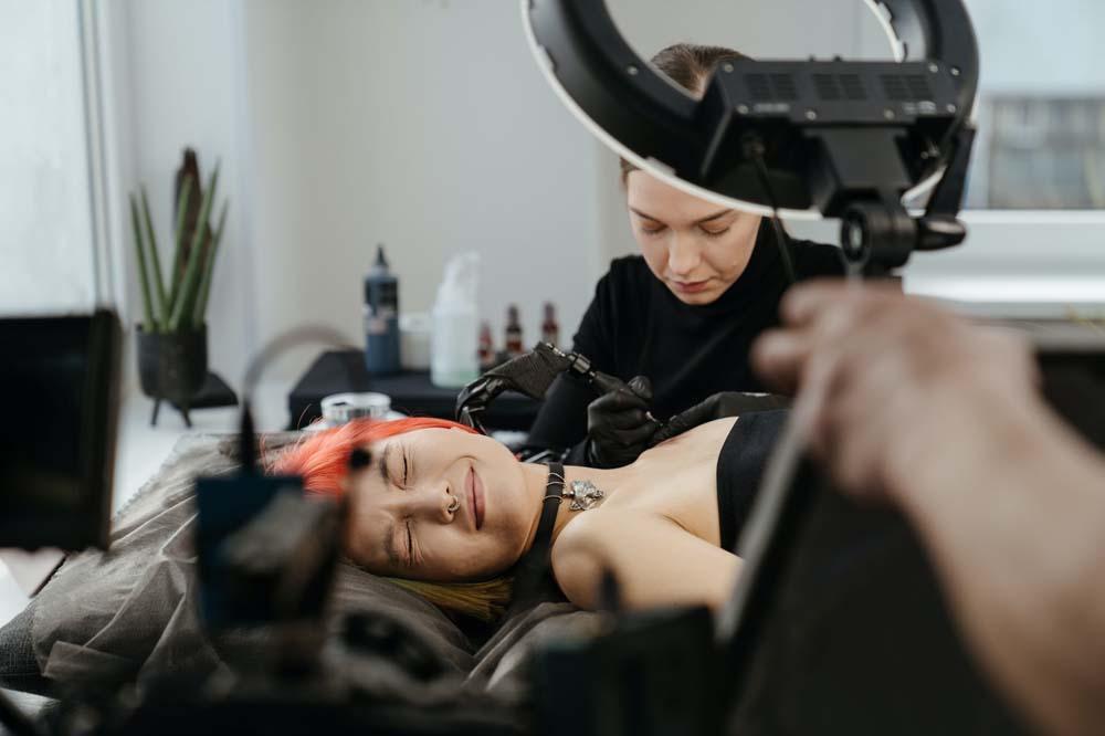 Woman getting a tattoo.