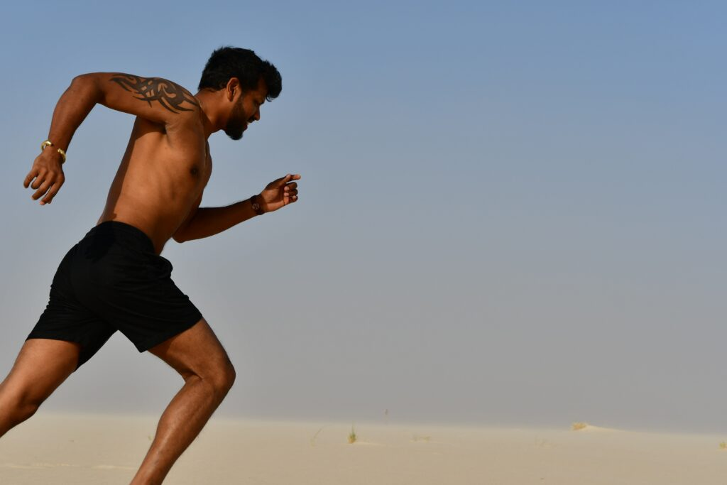 Man exercising with a tattoo.